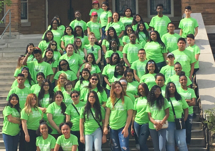 Group of students wearing green t-shirt